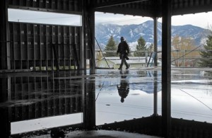 A worker walks through the framing of what will be the Bozeman High School library reading room.